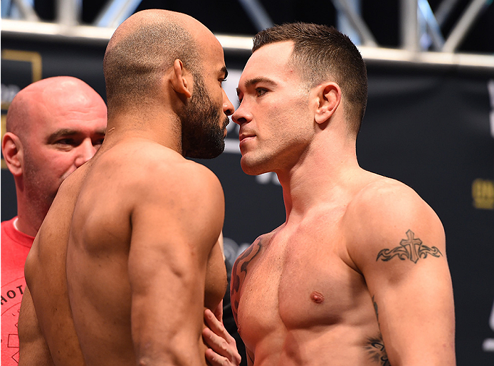 LAS VEGAS, NV - DECEMBER 11:   (L-R) Opponents Warlley Alves of Brazil and Colby Covington face off during the UFC 194 weigh-in inside MGM Grand Garden Arena on December 10, 2015 in Las Vegas, Nevada.  (Photo by Josh Hedges/Zuffa LLC/Zuffa LLC via Getty I