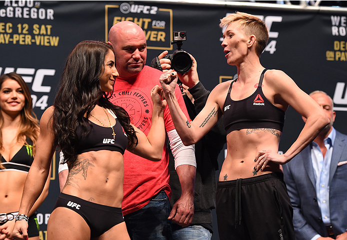 LAS VEGAS, NV - DECEMBER 11:   (L-R) Opponents Tecia Torres and Jocelyn Jones-Lybarger face off during the UFC 194 weigh-in inside MGM Grand Garden Arena on December 10, 2015 in Las Vegas, Nevada.  (Photo by Josh Hedges/Zuffa LLC/Zuffa LLC via Getty Image