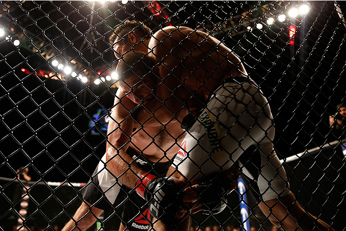 LAS VEGAS, NV - DECEMBER 12: Marcio Alexandre of Brazil (white trunks) grapples with Court McGee in their welterweight bout during the UFC 194 event inside MGM Grand Garden Arena on December 12, 2015 in Las Vegas, Nevada.  (Photo by Christian Petersen/Zuf