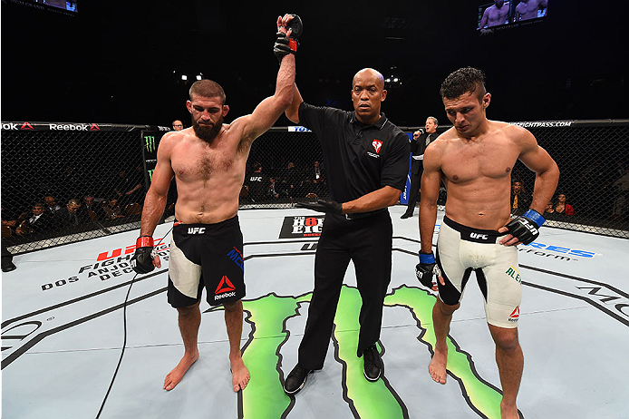 LAS VEGAS, NV - DECEMBER 12: Court McGee (left) is declared the winner over Marcio Alexandre of Brazil (right) in their welterweight bout during the UFC 194 event inside MGM Grand Garden Arena on December 12, 2015 in Las Vegas, Nevada.  (Photo by Josh Hed