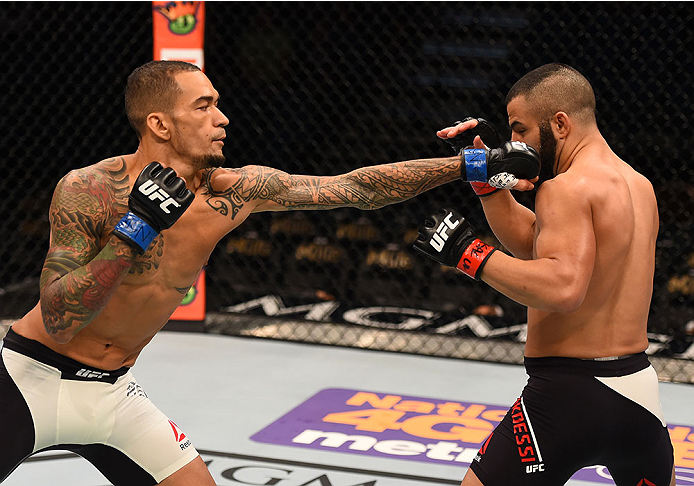 LAS VEGAS, NV - DECEMBER 12: (L-R) Yancy Medeiros punches John Makedssi of Canada in their lightweight bout during the UFC 194 event inside MGM Grand Garden Arena on December 12, 2015 in Las Vegas, Nevada.  (Photo by Josh Hedges/Zuffa LLC/Zuffa LLC via Ge