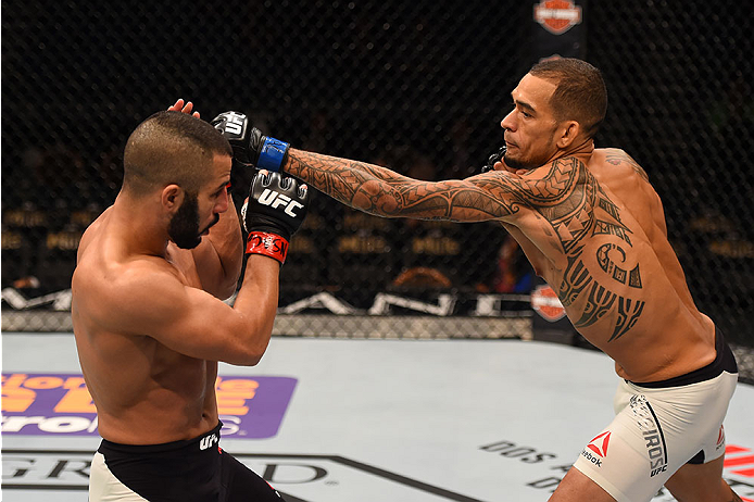 LAS VEGAS, NV - DECEMBER 12: (R-L) Yancy Medeiros punches John Makedssi of Canada in their lightweight bout during the UFC 194 event inside MGM Grand Garden Arena on December 12, 2015 in Las Vegas, Nevada.  (Photo by Josh Hedges/Zuffa LLC/Zuffa LLC via Ge