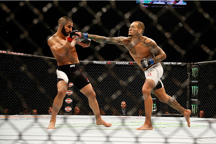 LAS VEGAS, NV - DECEMBER 12: (R-L) Yancy Medeiros punches John Makedssi of Canada in their lightweight bout during the UFC 194 event inside MGM Grand Garden Arena on December 12, 2015 in Las Vegas, Nevada.  (Photo by Christian Petersen/Zuffa LLC/Zuffa LLC