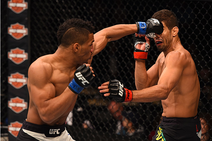 LAS VEGAS, NV - DECEMBER 12: (L-R) Kevin Lee punches Leonardo Santos of Brazil in their lightweight bout during the UFC 194 event inside MGM Grand Garden Arena on December 12, 2015 in Las Vegas, Nevada.  (Photo by Josh Hedges/Zuffa LLC/Zuffa LLC via Getty
