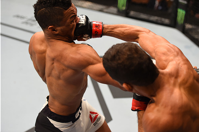 LAS VEGAS, NV - DECEMBER 12:  (R-L) Leonardo Santos of Brazil punches Kevin Lee in their lightweight bout during the UFC 194 event inside MGM Grand Garden Arena on December 12, 2015 in Las Vegas, Nevada.  (Photo by Josh Hedges/Zuffa LLC/Zuffa LLC via Gett