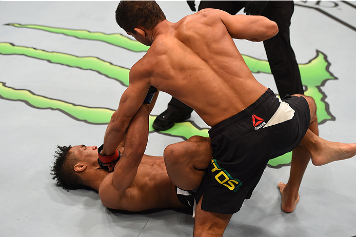 LAS VEGAS, NV - DECEMBER 12: (R-L) Leonardo Santos of Brazil punches Kevin Lee in their lightweight bout during the UFC 194 event inside MGM Grand Garden Arena on December 12, 2015 in Las Vegas, Nevada.  (Photo by Josh Hedges/Zuffa LLC/Zuffa LLC via Getty