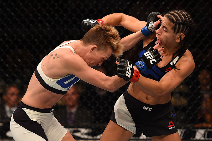 LAS VEGAS, NV - DECEMBER 12: (L-R) Jocelyn Jones-Lybarger punches Tecia Torres in their women's strawweight bout during the UFC 194 event inside MGM Grand Garden Arena on December 12, 2015 in Las Vegas, Nevada.  (Photo by Josh Hedges/Zuffa LLC/Zuffa LLC v
