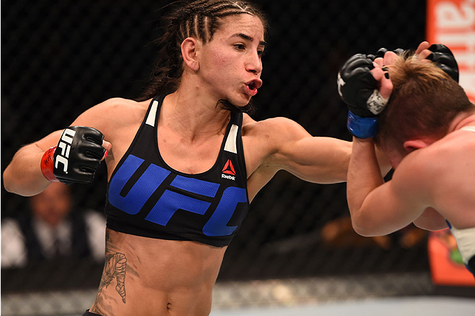 LAS VEGAS, NV - DECEMBER 12:  (L-R) Tecia Torres punches Jocelyn Jones-Lybarger in their women's strawweight bout during the UFC 194 event inside MGM Grand Garden Arena on December 12, 2015 in Las Vegas, Nevada.  (Photo by Josh Hedges/Zuffa LLC/Zuffa LLC