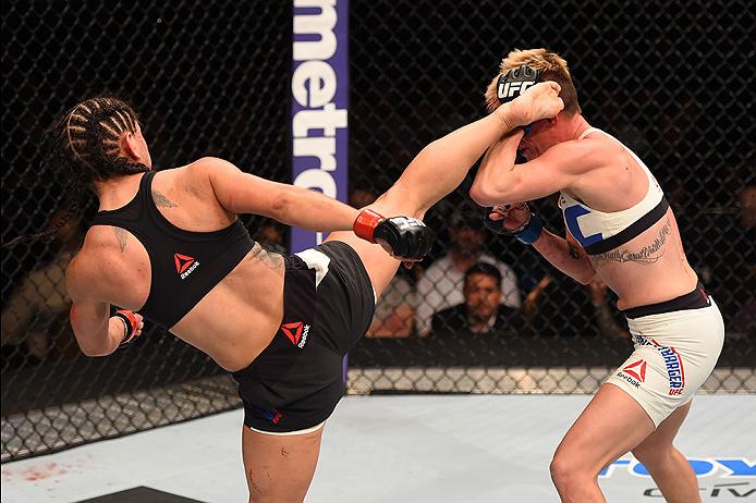 LAS VEGAS, NV - DECEMBER 12: (L-R) Tecia Torres kicks Jocelyn Jones-Lybarger in their women's strawweight bout during the UFC 194 event inside MGM Grand Garden Arena on December 12, 2015 in Las Vegas, Nevada.  (Photo by Josh Hedges/Zuffa LLC/Zuffa LLC via