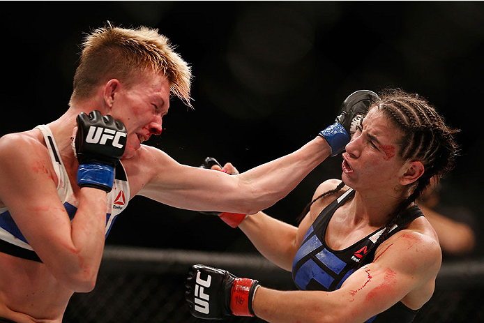 LAS VEGAS, NV - DECEMBER 12: (L-R) Jocelyn Jones-Lybarger punches Tecia Torres in their women's strawweight bout during the UFC 194 event inside MGM Grand Garden Arena on December 12, 2015 in Las Vegas, Nevada.  (Photo by Christian Petersen/Zuffa LLC/Zuff