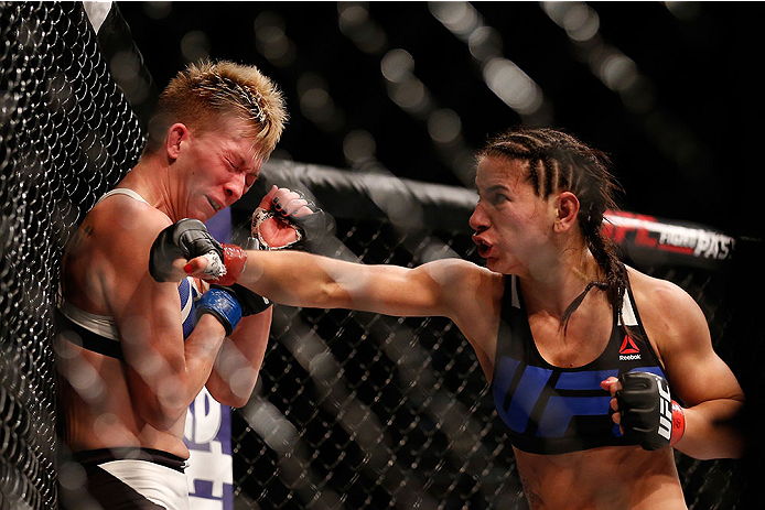 LAS VEGAS, NV - DECEMBER 12: (R-L) Tecia Torres punches Jocelyn Jones-Lybarger in their women's strawweight bout during the UFC 194 event inside MGM Grand Garden Arena on December 12, 2015 in Las Vegas, Nevada.  (Photo by Christian Petersen/Zuffa LLC/Zuff