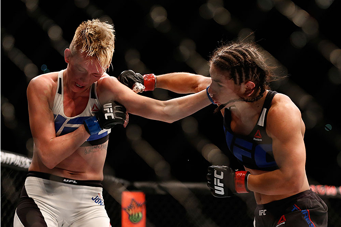 LAS VEGAS, NV - DECEMBER 12: (L-R) Jocelyn Jones-Lybarger and Tecia Torres exchange punches in their women's strawweight bout during the UFC 194 event inside MGM Grand Garden Arena on December 12, 2015 in Las Vegas, Nevada.  (Photo by Christian Petersen/Z