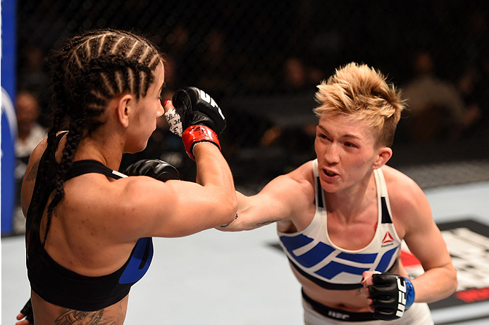LAS VEGAS, NV - DECEMBER 12:  (R) Jocelyn Jones-Lybarger punches Tecia Torres in their women's strawweight bout during the UFC 194 event inside MGM Grand Garden Arena on December 12, 2015 in Las Vegas, Nevada.  (Photo by Josh Hedges/Zuffa LLC/Zuffa LLC vi