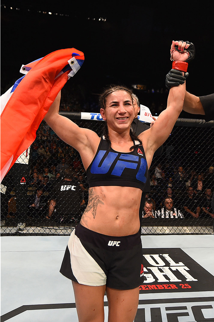 LAS VEGAS, NV - DECEMBER 12: Tecia Torres reacts to her victory over Jocelyn Jones-Lybarger in their women's strawweight bout during the UFC 194 event inside MGM Grand Garden Arena on December 12, 2015 in Las Vegas, Nevada.  (Photo by Josh Hedges/Zuffa LL