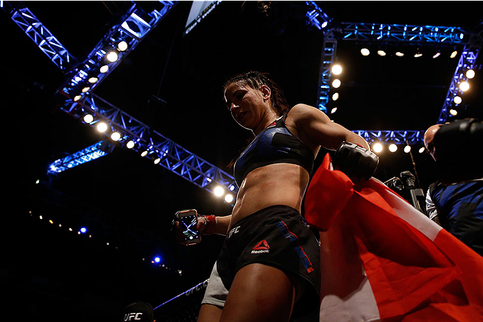 LAS VEGAS, NV - DECEMBER 12: Tecia Torres leaves the Octagon after defeating Jocelyn Jones-Lybarger in their women's strawweight bout during the UFC 194 event inside MGM Grand Garden Arena on December 12, 2015 in Las Vegas, Nevada.  (Photo by Christian Pe