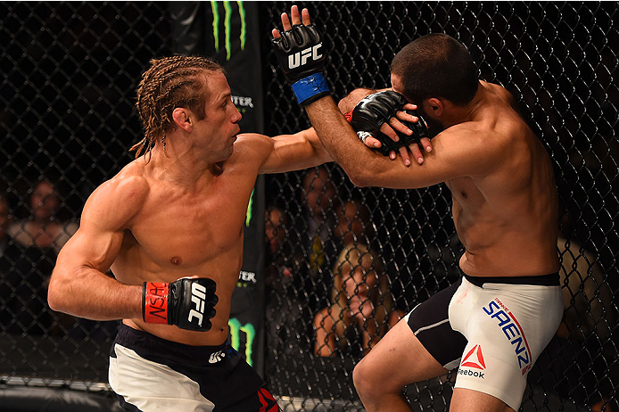 LAS VEGAS, NV - DECEMBER 12: (L-R) Urijah Faber punches Frankie Saenz in their bantamweight bout during the UFC 194 event inside MGM Grand Garden Arena on December 12, 2015 in Las Vegas, Nevada.  (Photo by Josh Hedges/Zuffa LLC/Zuffa LLC via Getty Images)