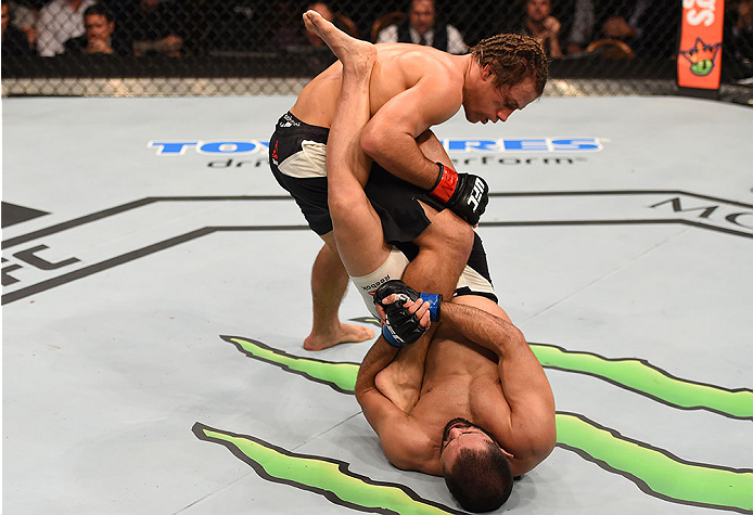 LAS VEGAS, NV - DECEMBER 12: Frankie Saenz (bottom) attempts to submit Urijah Faber in their bantamweight bout during the UFC 194 event inside MGM Grand Garden Arena on December 12, 2015 in Las Vegas, Nevada.  (Photo by Josh Hedges/Zuffa LLC/Zuffa LLC via