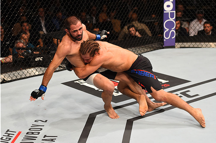 LAS VEGAS, NV - DECEMBER 12: Urijah Faber (right) takes down Frankie Saenz in their bantamweight bout during the UFC 194 event inside MGM Grand Garden Arena on December 12, 2015 in Las Vegas, Nevada.  (Photo by Josh Hedges/Zuffa LLC/Zuffa LLC via Getty Im