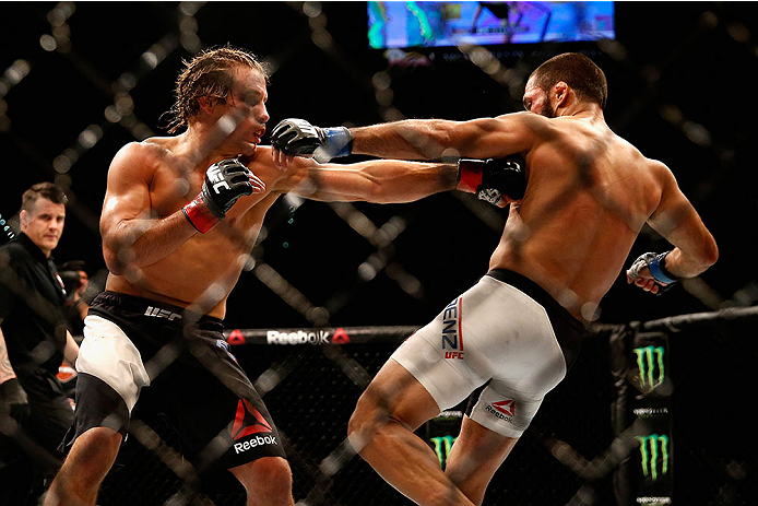 LAS VEGAS, NV - DECEMBER 12: Urijah Faber (left) punches Frankie Saenz in their bantamweight bout during the UFC 194 event inside MGM Grand Garden Arena on December 12, 2015 in Las Vegas, Nevada.  (Photo by Christian Petersen/Zuffa LLC/Zuffa LLC via Getty