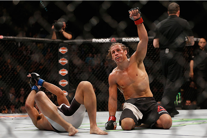 LAS VEGAS, NV - DECEMBER 12: Urijah Faber (right) reacts after his fight with Frankie Saenz (left) during the UFC 194 event inside MGM Grand Garden Arena on December 12, 2015 in Las Vegas, Nevada.  (Photo by Christian Petersen/Zuffa LLC/Zuffa LLC via Gett