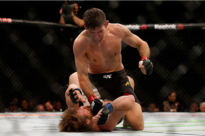 LAS VEGAS, NV - DECEMBER 12: Demian Maia of Brazil (top) punches Gunnar Nelson of Iceland in their welterweight bout during the UFC 194 event inside MGM Grand Garden Arena on December 12, 2015 in Las Vegas, Nevada.  (Photo by Christian Petersen/Zuffa LLC/