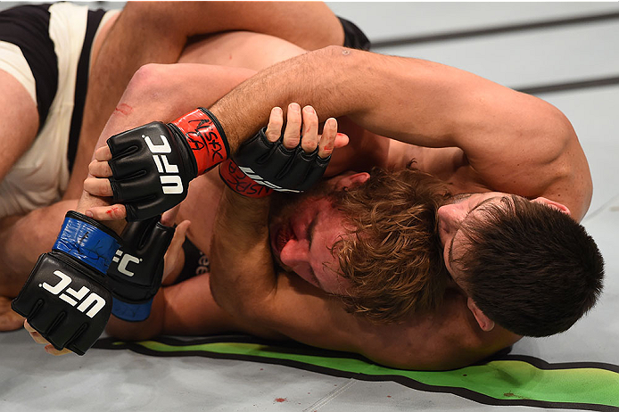 LAS VEGAS, NV - DECEMBER 12: (R-L) Demian Maia of Brazil attempts to submit Gunnar Nelson of Iceland in their welterweight bout during the UFC 194 event inside MGM Grand Garden Arena on December 12, 2015 in Las Vegas, Nevada.  (Photo by Josh Hedges/Zuffa