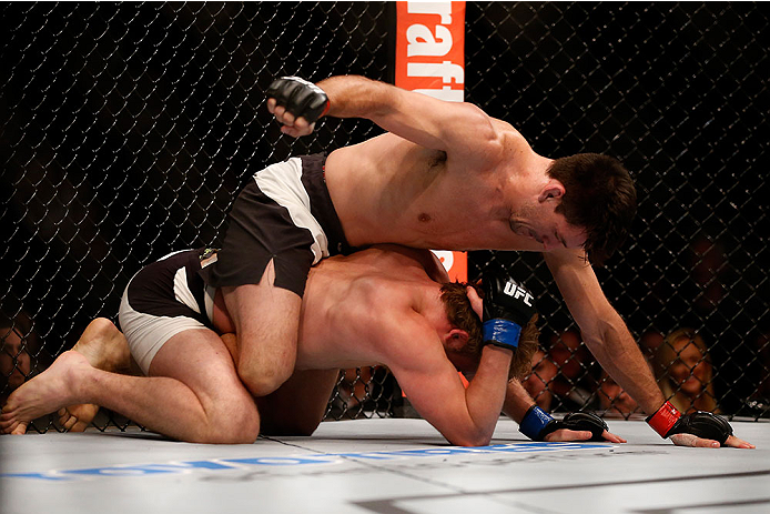 LAS VEGAS, NV - DECEMBER 12:  (Top) Demian Maia punches Gunnar Nelson in their welterweight bout during the UFC 194 event inside MGM Grand Garden Arena on December 12, 2015 in Las Vegas, Nevada.  (Photo by Christian Petersen/Zuffa LLC/Zuffa LLC via Getty