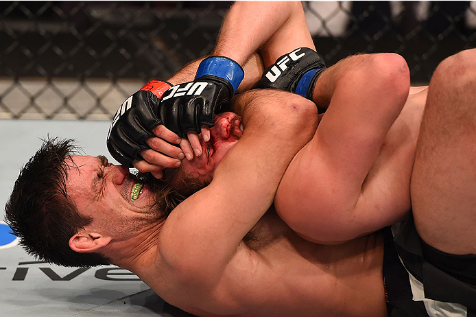 LAS VEGAS, NV - DECEMBER 12: Demian Maia of Brazil (bottom) attempts to submit Gunnar Nelson of Iceland in their welterweight bout during the UFC 194 event inside MGM Grand Garden Arena on December 12, 2015 in Las Vegas, Nevada.  (Photo by Josh Hedges/Zuf