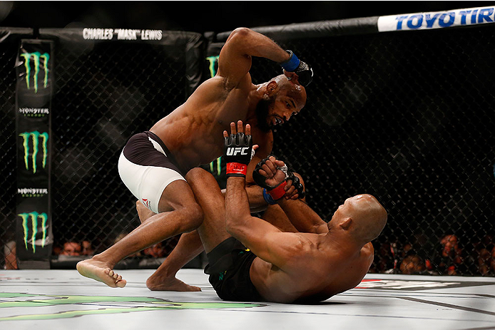 LAS VEGAS, NV - DECEMBER 12: Yoel Romero of Cuba (top) punches Ronaldo 'Jacare' Souza of Brazil in their middleweight bout during the UFC 194 event inside MGM Grand Garden Arena on December 12, 2015 in Las Vegas, Nevada.  (Photo by Christian Petersen/Zuff