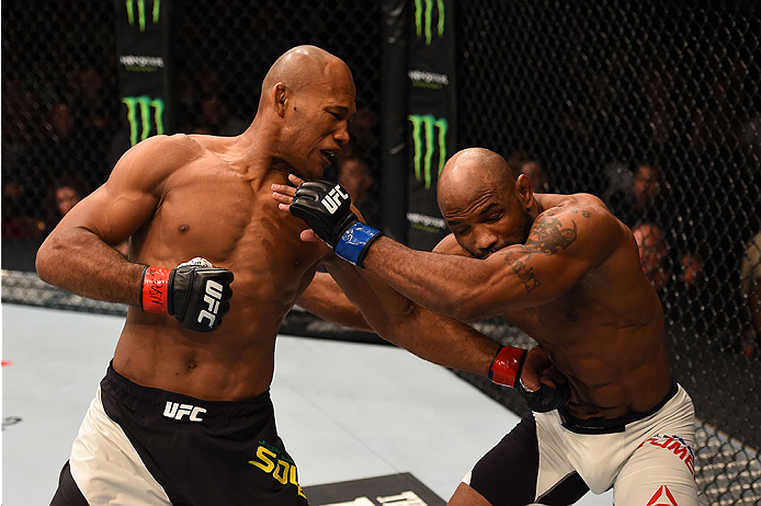 LAS VEGAS, NV - DECEMBER 12: (L-R) Ronaldo 'Jacare' Souza of Brazil punches Yoel Romero of Cuba in their middleweight bout during the UFC 194 event inside MGM Grand Garden Arena on December 12, 2015 in Las Vegas, Nevada.  (Photo by Josh Hedges/Zuffa LLC/Z