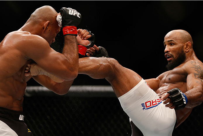 LAS VEGAS, NV - DECEMBER 12: (R-L) Yoel Romero of Cuba kicks Ronaldo 'Jacare' Souza of Brazil in their middleweight bout during the UFC 194 event inside MGM Grand Garden Arena on December 12, 2015 in Las Vegas, Nevada.  (Photo by Christian Petersen/Zuffa