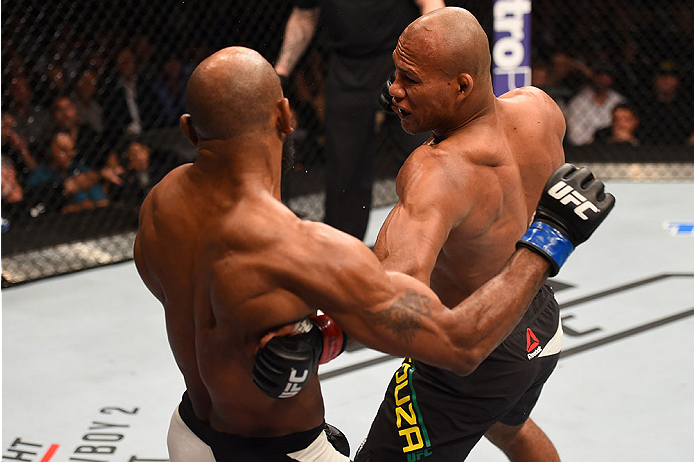 LAS VEGAS, NV - DECEMBER 12: (R-L) Ronaldo 'Jacare' Souza of Brazil punches Yoel Romero of Cuba in their middleweight bout during the UFC 194 event inside MGM Grand Garden Arena on December 12, 2015 in Las Vegas, Nevada.  (Photo by Josh Hedges/Zuffa LLC/Z