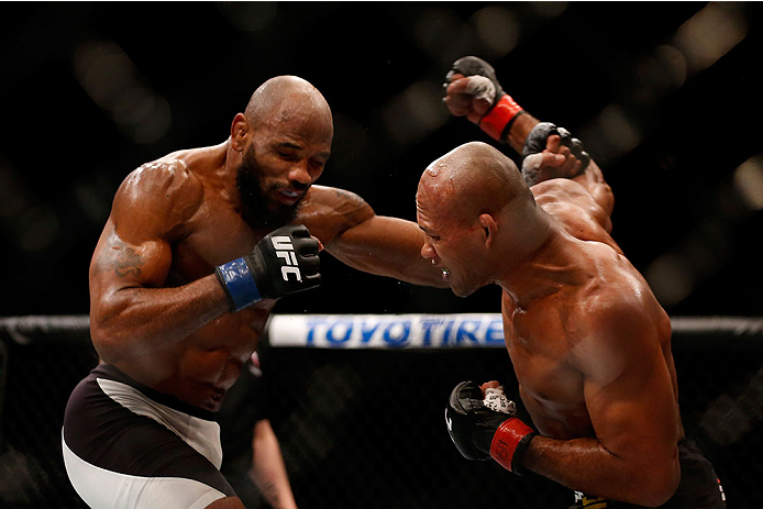 LAS VEGAS, NV - DECEMBER 12: (R-L) Ronaldo 'Jacare' Souza of Brazil punches Yoel Romero of Cuba in their middleweight bout during the UFC 194 event inside MGM Grand Garden Arena on December 12, 2015 in Las Vegas, Nevada.  (Photo by Christian Petersen/Zuff