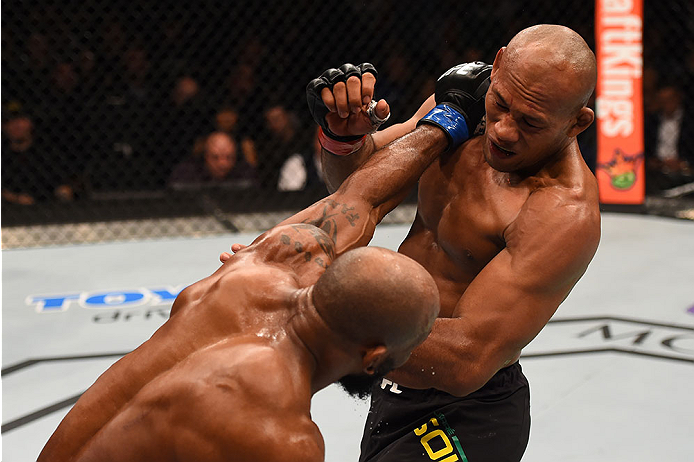LAS VEGAS, NV - DECEMBER 12:  (L-R) Yoel Romero of Cuba punches Ronaldo 'Jacare' Souza of Brazil in their middleweight bout during the UFC 194 event inside MGM Grand Garden Arena on December 12, 2015 in Las Vegas, Nevada.  (Photo by Josh Hedges/Zuffa LLC/
