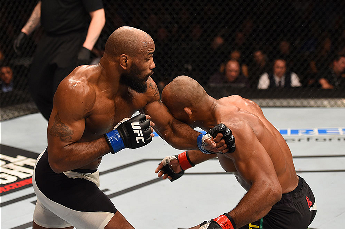 LAS VEGAS, NV - DECEMBER 12: (L-R) Yoel Romero of Cuba punches Ronaldo 'Jacare' Souza of Brazil in their middleweight bout during the UFC 194 event inside MGM Grand Garden Arena on December 12, 2015 in Las Vegas, Nevada.  (Photo by Josh Hedges/Zuffa LLC/Z