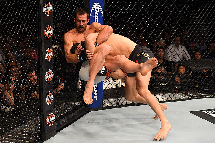 LAS VEGAS, NV - DECEMBER 12: Chris Weidman (right) takes down Luke Rockhold in their UFC middleweight championship bout during the UFC 194 event inside MGM Grand Garden Arena on December 12, 2015 in Las Vegas, Nevada.  (Photo by Josh Hedges/Zuffa LLC/Zuff