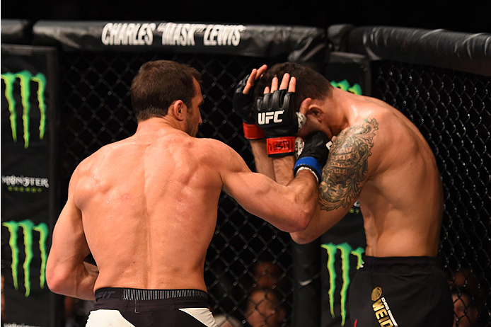 LAS VEGAS, NV - DECEMBER 12: (L-R) Luke Rockhold punches Chris Weidman in their UFC middleweight championship bout during the UFC 194 event inside MGM Grand Garden Arena on December 12, 2015 in Las Vegas, Nevada.  (Photo by Josh Hedges/Zuffa LLC/Zuffa LLC