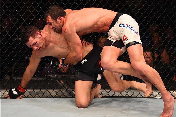 LAS VEGAS, NV - DECEMBER 12: Luke Rockhold (right) takes down Chris Weidman in their UFC middleweight championship bout during the UFC 194 event inside MGM Grand Garden Arena on December 12, 2015 in Las Vegas, Nevada.  (Photo by Josh Hedges/Zuffa LLC/Zuff