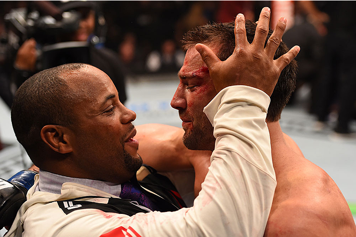 LAS VEGAS, NV - DECEMBER 12:  (L-R) UFC light heavyweight champion Daniel Cormier celebrates with Luke Rockhold after his victory over Chris Weidman in their UFC middleweight championship bout during the UFC 194 event inside MGM Grand Garden Arena on Dece