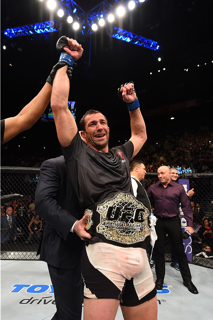LAS VEGAS, NV - DECEMBER 12: Luke Rockhold reacts to his victory over Chris Weidman in their UFC middleweight championship bout during the UFC 194 event inside MGM Grand Garden Arena on December 12, 2015 in Las Vegas, Nevada.  (Photo by Josh Hedges/Zuffa