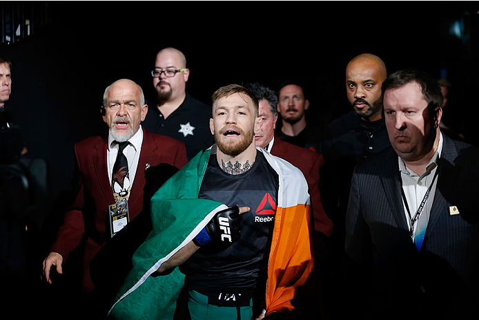 LAS VEGAS, NV - DECEMBER 12: Conor McGregor of Ireland walks to the Octagon to face Jose Aldo of Brazil in their UFC welterweight championship bout during the UFC 194 event inside MGM Grand Garden Arena on December 12, 2015 in Las Vegas, Nevada.  (Photo b