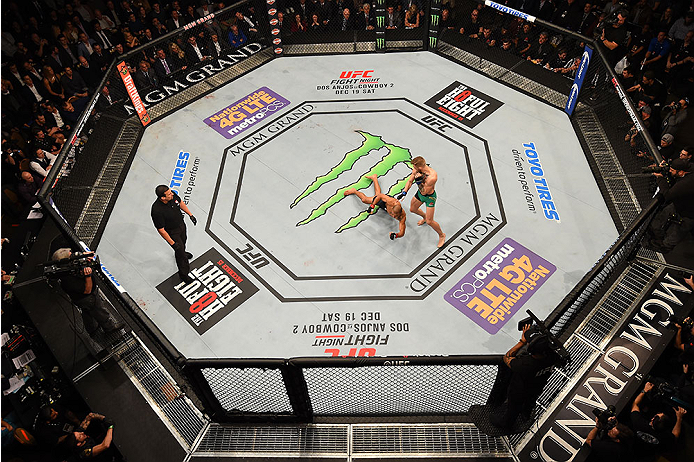 LAS VEGAS, NV - DECEMBER 12:  An overhead view of the Octagon as Conor McGregor of Ireland punches Jose Aldo of Brazil during the UFC 194 event inside MGM Grand Garden Arena on December 12, 2015 in Las Vegas, Nevada.  (Photo by Zuffa LLC/Zuffa LLC via Get