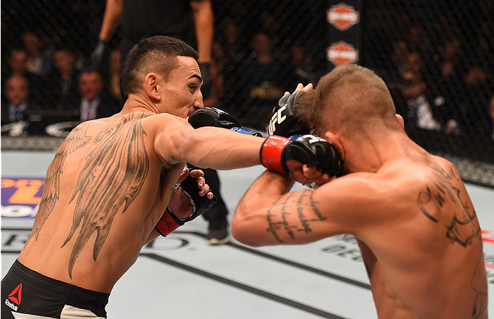 LAS VEGAS, NV - DECEMBER 12: (L-R) Max Holloway punches Jeremy Stephens in their featherweight bout during the UFC 194 event inside MGM Grand Garden Arena on December 12, 2015 in Las Vegas, Nevada.  (Photo by Josh Hedges/Zuffa LLC/Zuffa LLC via Getty Imag