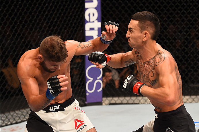 LAS VEGAS, NV - DECEMBER 12: (R-L) Max Holloway punches Jeremy Stephens in their featherweight bout during the UFC 194 event inside MGM Grand Garden Arena on December 12, 2015 in Las Vegas, Nevada.  (Photo by Josh Hedges/Zuffa LLC/Zuffa LLC via Getty Imag