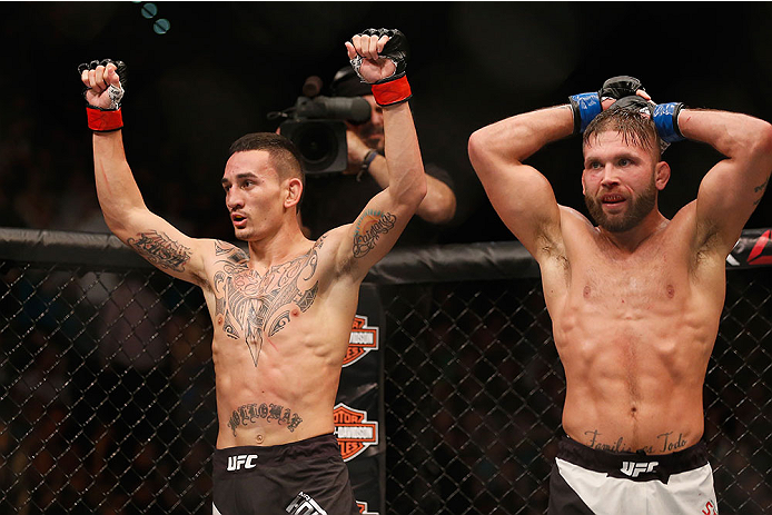 LAS VEGAS, NV - DECEMBER 12: (L-R) Max Holloway and Jeremy Stephens react after their featherweight bout during the UFC 194 event inside MGM Grand Garden Arena on December 12, 2015 in Las Vegas, Nevada.  (Photo by Christian Petersen/Zuffa LLC/Zuffa LLC vi