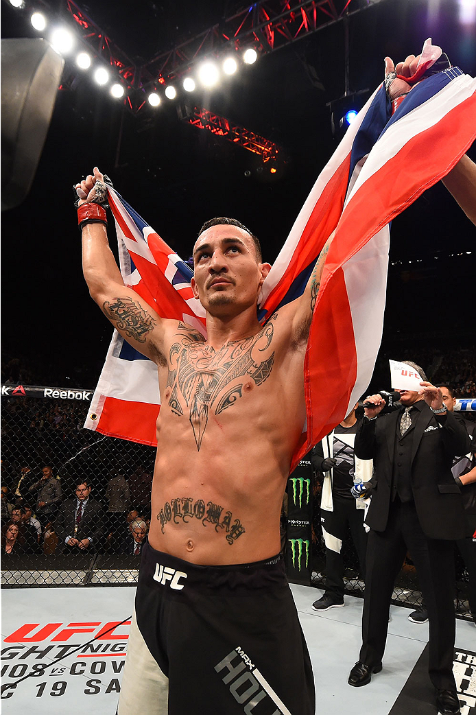 LAS VEGAS, NV - DECEMBER 12: Max Holloway reacts to being declared the winner against Jeremy Stephens in their featherweight bout during the UFC 194 event inside MGM Grand Garden Arena on December 12, 2015 in Las Vegas, Nevada.  (Photo by Josh Hedges/Zuff