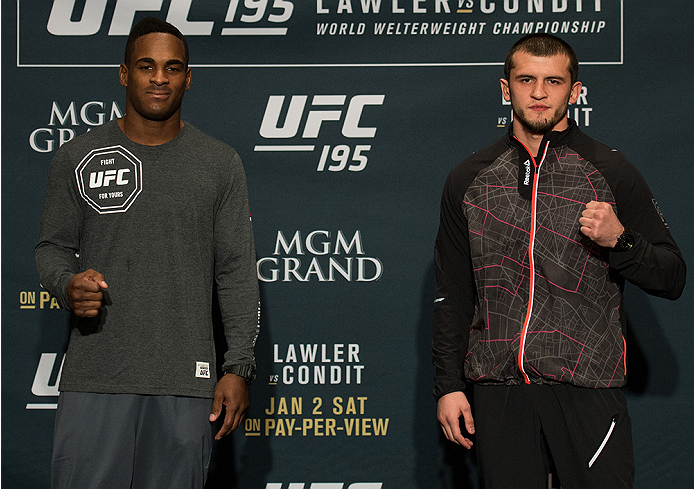 LAS VEGAS, NEVADA - DECEMBER 31:  (L-R) Lorenz Larkin and Albert Tumenov pose for a picture after facing off during the Ultimate Media Day at the MGM Grand Hotel/Casino on December 31, 2015 in Las Vegas Nevada. (Photo by Brandon Magnus/Zuffa LLC/Zuffa LLC