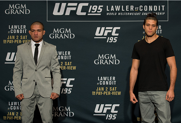 LAS VEGAS, NEVADA - DECEMBER 31:  (L-R) Diego Brandao and Brian Ortega pose for a photo after facing off during the Ultimate Media Day at the MGM Grand Hotel/Casino on December 31, 2015 in Las Vegas Nevada. (Photo by Brandon Magnus/Zuffa LLC/Zuffa LLC via