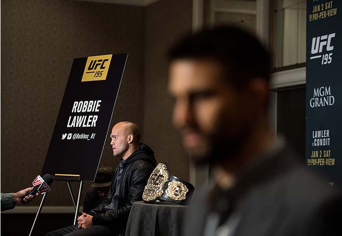 LAS VEGAS, NEVADA - DECEMBER 31:  (L-R) UFC welterweight champion Robbie Lawler and Carlos Condit speak to the media during the Ultimate Media Day at the MGM Grand Hotel/Casino on December 31, 2015 in Las Vegas Nevada. (Photo by Brandon Magnus/Zuffa LLC/Z