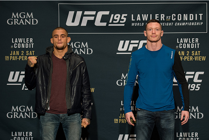 LAS VEGAS, NEVADA - DECEMBER 31:  (L-R) Dustin Poirier and Joe Duffey pose for a picture after facing off during the Ultimate Media Day at the MGM Grand Hotel/Casino on December 31, 2015 in Las Vegas Nevada. (Photo by Brandon Magnus/Zuffa LLC/Zuffa LLC vi